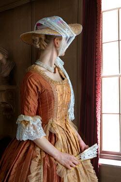 Lee Avison wealthy georgian period woman looking towards a window