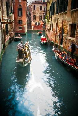 Michael Trevillion VENETIAN CANAL WITH TOURISTS ON GONDOLAS Miscellaneous Cities/Towns