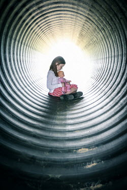 Stephen Carroll LITTLE GIRL WITH DOLL SITTING IN TUNNEL Children