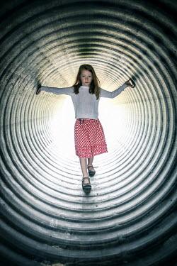 Stephen Carroll LITTLE GIRL STANDING IN CIRCULAR TUNNEL Children