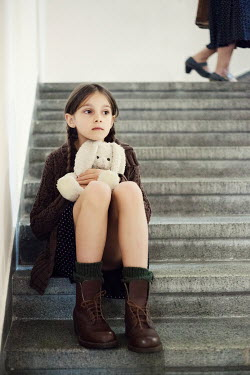 Svetoslava Madarova SAD GIRL ON STEPS WITH TOY Children
