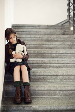 Svetoslava Madarova SAD GIRL WITH TOY SITTING ON STEPS Children