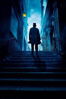 Stephen Mulcahey VICTORIAN MAN ON CITY STEPS AT NIGHT Men