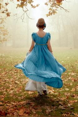 ILINA SIMEONOVA Vintage woman walking in Autumn field Women