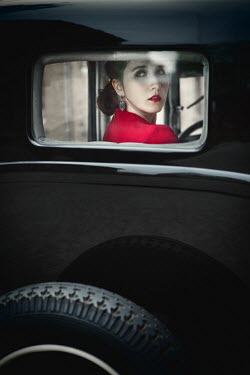 Magdalena Russocka WOMAN IN CLASSIC CAR WATCHING FROM REAR WINDOW Women