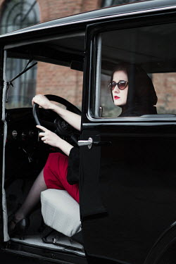 Magdalena Russocka retro woman in classic car