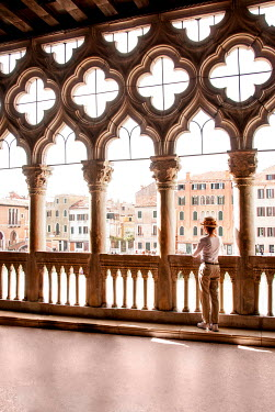Michael Trevillion WOMAN IN GRAND VENETIAN BUILDING WATCHING CANAL Women