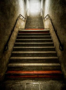 Jaroslaw Blaminsky EMPTY STAIRCASE IN STONE BUILDING Stairs/Steps