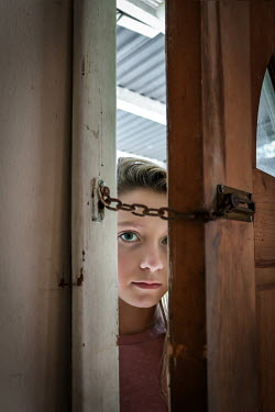 Stephen Carroll GIRL PEERING THROUGH DOOR WITH CHAIN Children