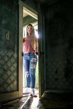 Stephen Carroll GIRL IN JEANS OPENING DOOR OF ABANDONED HOUSE Women