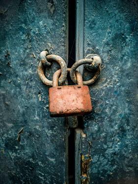 Jaroslaw Blaminsky DOOR HANDLES LOCKED WITH RUSTY PADLOCK Building Detail