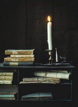 Jane Morley HISTORICAL BOOKS DOCUMENTS AND CANDLE ON SIDEBOARD Interiors/Rooms