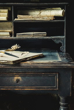 Jane Morley DOCUMENTS BOOKS AND PEN ON OLD DESK Interiors/Rooms