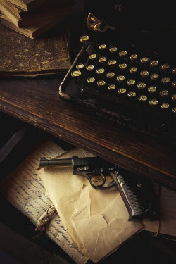 Jane Morley TYPEWRITER ON DESK WITH GUN AND LETTERS IN DRAWER Weapons