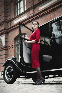 Magdalena Russocka retro woman standing by classic car