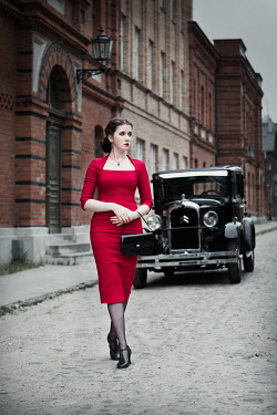 Magdalena Russocka retro woman in red dress and classic car