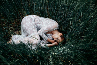 Nathalie Seiferth GIRL IN LACE LYING IN LONG GRASS Women