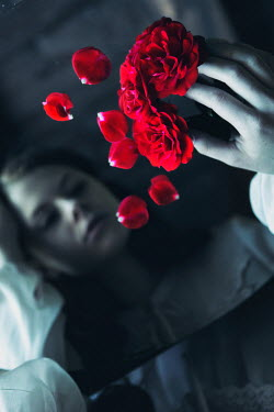 Magdalena Russocka sad woman with mirror and roses petals