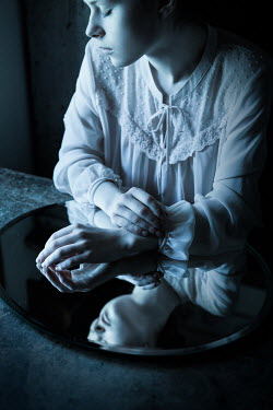 Magdalena Russocka sad woman with mirror at night