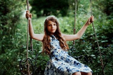 Nathalie Seiferth YOUNG GIRL SITTING ON SWING Children