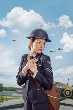 CollaborationJS WW2 RAF WOMAN NEAR AEROPLANE Women