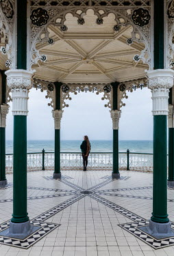 Maggie McCall WOMAN STANDING ON OLD SEASIDE BANDSTAND Women