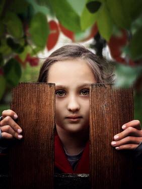 Elisabeth Ansley GIRL LOOKING BETWEEN FENCE POSTS Children