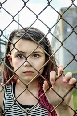 Stephen Carroll SAD YOUNG GIRL BEHIND WIRE FENCE Children