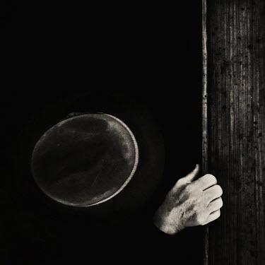 Oana Stoian Hand on door in darkness Body Detail