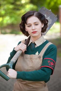 Lee Avison land girl with spade waist up