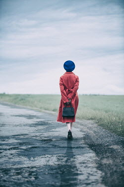 Magdalena Russocka woman walking on country road