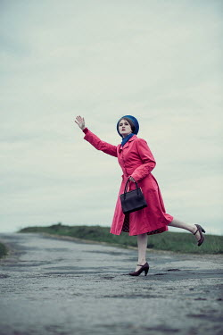 Magdalena Russocka woman stopping the car on country road