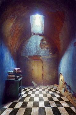 Jill Battaglia Derelict room with books. Interiors/Rooms