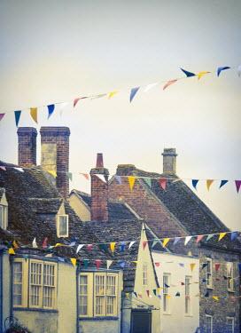 Jill Battaglia English village with bunting. Houses