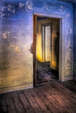 Jill Battaglia Shadow in doorway of abandoned house Interiors/Rooms