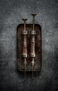 Jaroslaw Blaminsky Two rusty syringes on tray Miscellaneous Objects