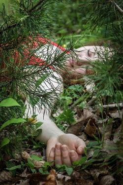 Stephen Carroll Girl lying on floor in woods Women