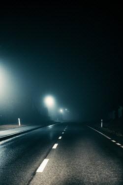 Magdalena Russocka foggy suburban road at night Roads