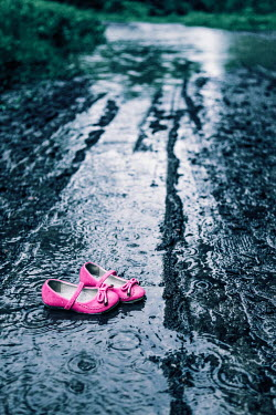 Magdalena Russocka Pink children shoes in mud Miscellaneous Objects