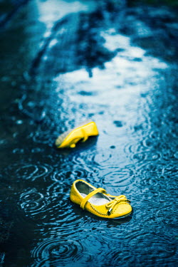 Magdalena Russocka Yellow children shoes in puddle Miscellaneous Objects