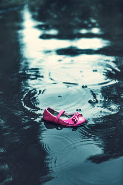 Magdalena Russocka pink child's shoe in water Miscellaneous Objects