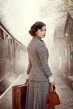 Lee Avison 1940s woman on a train platform Women