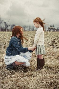 Robin Macmillan Girls holding hands in field Children