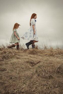 Robin Macmillan Two girls walking in field Children