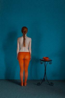 Alexander Kuzovkov Topless woman in orange tights Women
