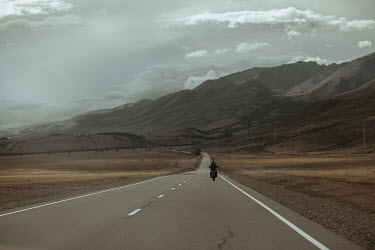 Alexander Kuzovkov Motorcyclist on road by mountains Men