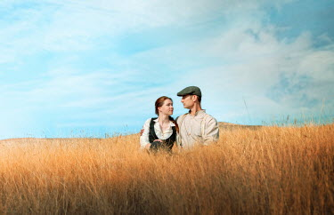 Mary Wethey Couple walking in tall crops Couples
