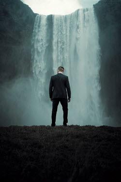 Rekha Garton Man in suit by waterfall Men