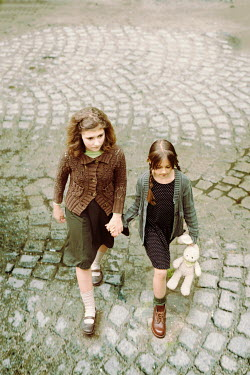 Svetoslava Madarova Two retro girls holding hands Children