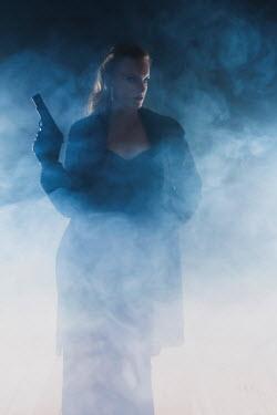 Ysbrand Cosijn WOMAN HOLDING GUN IN MIST Women